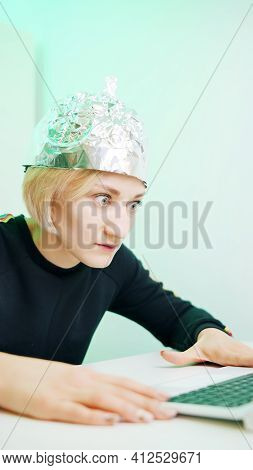 Crazy Young Woman With Aluminum Hat Reacting Badly On The Conspiracy Theory Post About 5g Microwaves