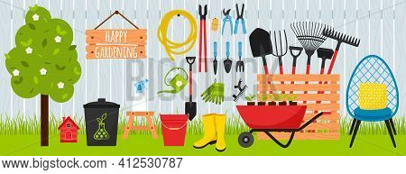 A Collection Of Garden Tools And Equipment For Gardening On The Background Of A Wooden Fence And Law