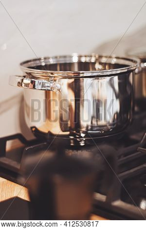 Aluminium Pot On A Kitchen Stove, Cookware And Cooking Concept