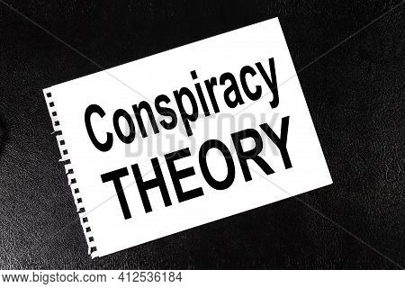 Conspiracy Theory. Text On White Paper On Black Background
