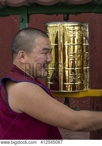Mörön, Mongolia - August 17, 2019: Buddhist Monk Wit Red Habit Clothes In Buddhist Temple At The Pra