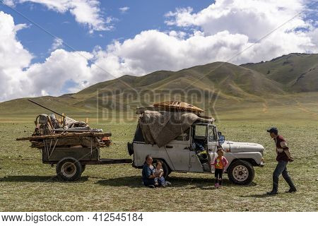 Baruuntunuun, Mongolia - August 8, 2019: Nomadic Life On The Steppe Of Mongolia With Moving Family W