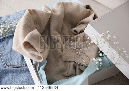 Soft Cashmere Sweater In Box On Sofa, Closeup