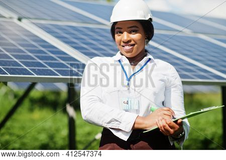 African American Technician Check The Maintenance Of The Solar Panels. Black Woman Engineer At Solar
