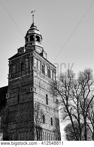 Belfry Of The Gothic Church In Osno In Poland, Monochrome