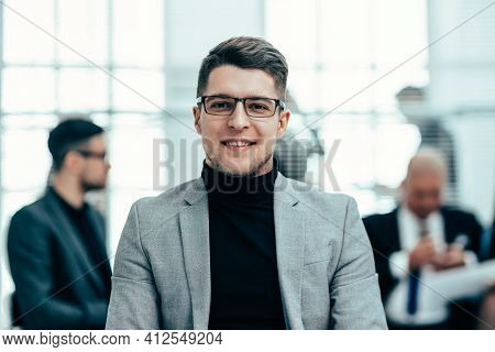 Confident Business Man Standing In The Office