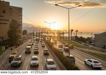 Izmir, Turkey - November 5, 2019: Busy traffic road at sunset in Izmir, Turkey. Izmir is a third most populated city in Turkey.