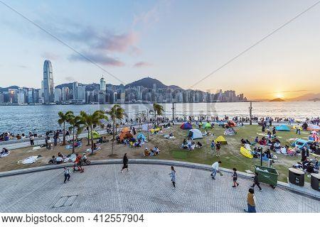 Hong Kong, China  - 31 January, 2021 :  Seaside Promenade Of Victoria Harbor In Hong Kong City Under