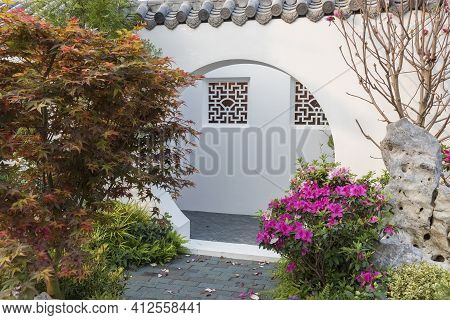 A Moon Gate Is A Circular Opening In A Garden Wall That Acts As A Pedestrian Passageway, And A Tradi