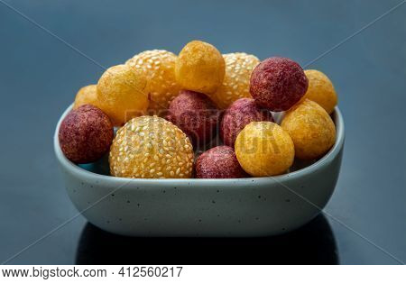 Fried Sweet Potato Balls With Sesame With Deep Fried Purple And Yellow Sweet Potato Balls (quail Can