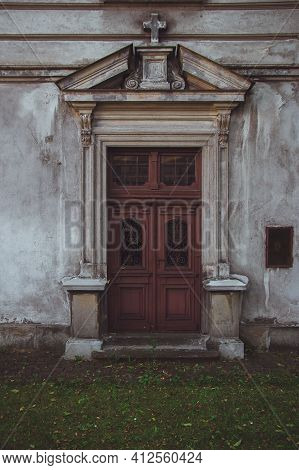Seminary Entrance In Przemysl, Poland. Decoration Of The Doors Of Buildings In The Old Town. Very Ol