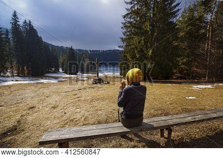 Woman Admiring The Beautiful And Volcanic Lake Saint Ana In The Winter Time. Saint Ana Volcanic Lake