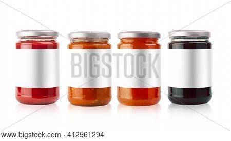 Front View Of Set Of Small Jam And Vegetable Jars In Different Colors With Empty Blank Labels And Sh