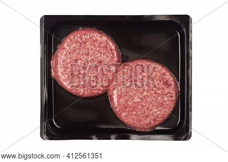 Top View Of Burger Beef Meat For Hamburger In Vacuum Plastic Black Packaging Isolated On White Backg