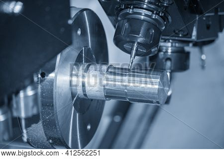 The  Multi-tasking Cnc Lathe Machine Making The Metal Shaft Parts By Milling Turret. The Hi-technolo