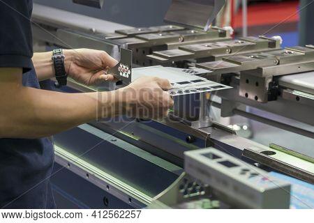 The Technician Operator Working With Press Brake Hydraulic Bending Machine. The Sheet Metal Working