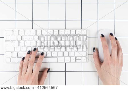 Top View Female Hand Using Computer Keyboard. Hand Typing On Desktop Office Computer Keyboard. Woman