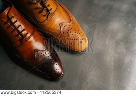 Close-up Top View Of Old Light Brown Leather Shoe And Repaired Shiny Shoes After Restoration Working
