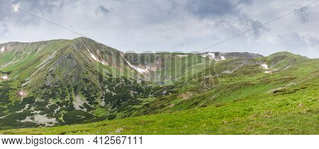 Mountain Range With Slopes Covered With Rocky Outcrops And Mountain Pine Thicket, Small Lake And Alp