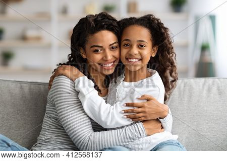 Beautiful Black Mother And Daughter Bonding At Home