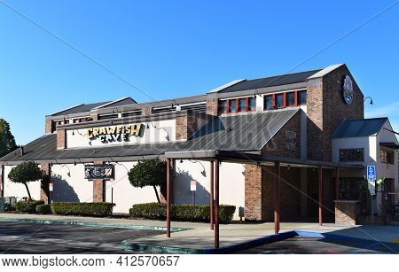 FULLERTON, CALIFORNIA - 24 JAN 2020: Crawfish Cave Restaurant, a Warehouse-style hangout for seafood with Cajun and Asian flavors.