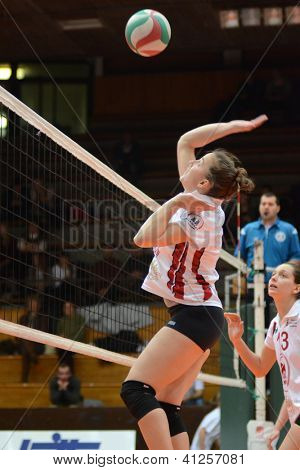 KAPOSVAR, HUNGARY - JANUARY 13: Zsanett Pinter (C) in action at the Hungarian I. League volleyball game Kaposvar (white) vs Budapest SE (white), January 13, 2013 in Kaposvar, Hungary.