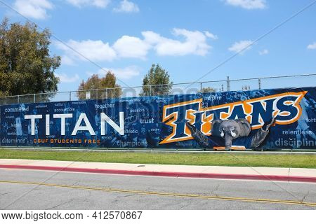 FULLERTON CALIFORNIA - 23 MAY 2020: Titans banner on the Tennis Court fence on the campus of California State University Fullerton, CSUF.