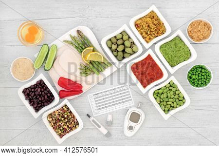 Low glycemic diabetic health food with blood sugar testing and lancing devices with meal chart  and foods below 55 on the GI index, high in antioxidants, omega 3, protein, anthocyanins, vitamins.