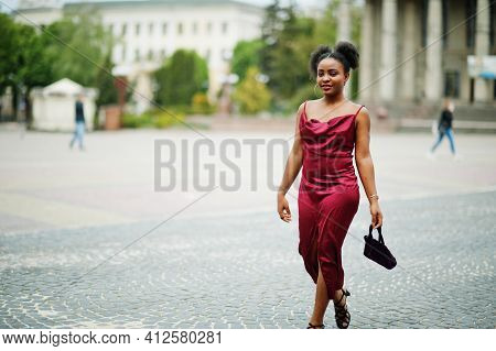 Portrait Of A Beautiful Natural Young African Woman With Afro Hair. Black Model In Red Silk Dress.