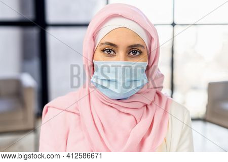 Close Up Head Shot Portrait Young Serious Cautious Arabic Ethnic Woman Employee Worker Wearing Prote
