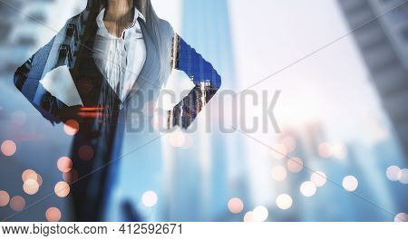 Successful Business Concept With Woman In Black Suit On Blurry Megapolis City Skyscrapers Background