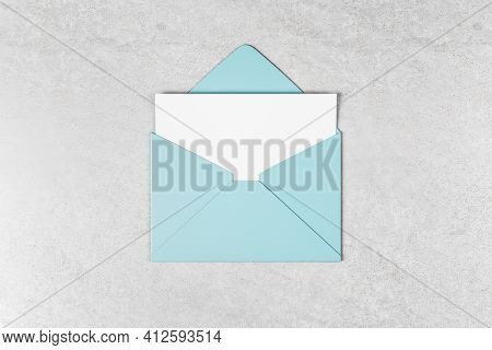 White Blank Gift Card In Tiffany Color Envelope On Concrete Surface. Mockup, 3d Rendering