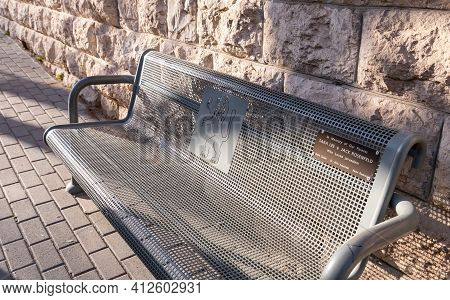 Jerusalem, Israel, February 27, 2021 : Evening View Of A Metal Public Bench With The Coat Of Arms Of
