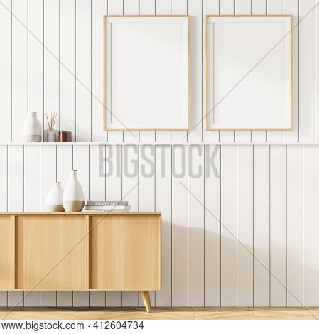 Living Room Interior With A Cosy Wooden Cabinet. White Wall Is Decorated With Two Vertical Poster. M