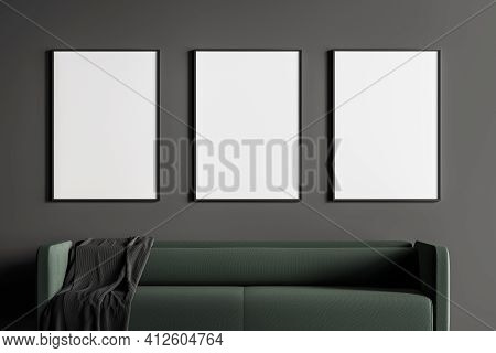 Close Up Modern Living Or Waiting Room Interior With Furnished By Green Sofa And Three White Empty P