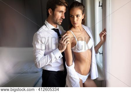 Passionate Couple Is Having Sex In A Bedroom. Portrait Of Passion, Pleasure, Sex, Relationship.