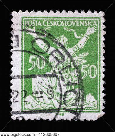 ZAGREB, CROATIA - SEPTEMBER 18, 2014: Stamp printed in Czechoslovakia shows Breaking Chains to Freedom, Series Allegory of Republic, circa 1922