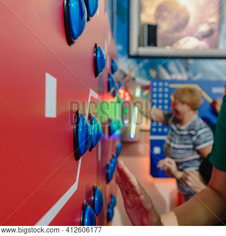 Dnepr, Ukraine- September 06, 2020: Closeup Photo Of Children And Adults Playing Games On Arcade Mac