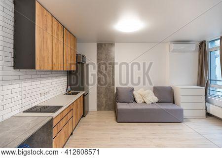 Stylish Scandinavian Living Room With Design Furniture, Plants, Wooden Desk. Wooden Parquet. Nice Ap