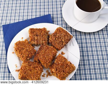 Homemade Flapjack Biscuits Served With A Cup Of Coffee