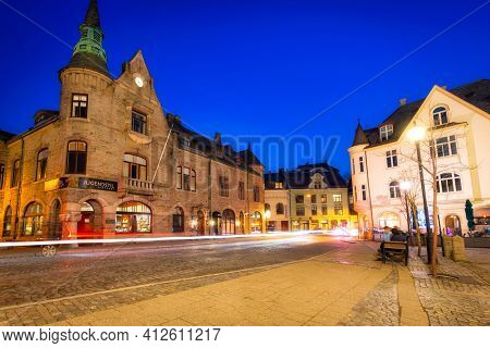 Alesund, Norway - April 14, 2018: Architecture of Alesund city at night, Norway. Alesund is a town and municipality in west Norway.