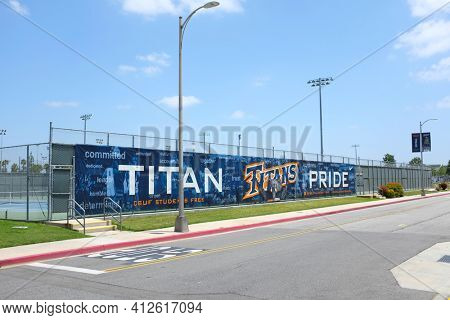 FULLERTON CALIFORNIA - 23 MAY 2020: Titans Pride Panner on the Tennis Courts fence on the Campus of California State University Fullerton, CSUf.