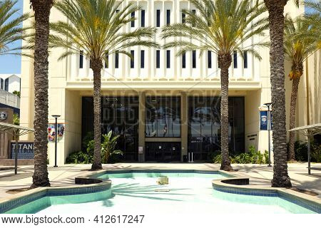 FULLERTON CALIFORNIA - 23 MAY 2020:  Langsdorf Hall and fountain at the main entrance to California State University Fullerton, CSUF.
