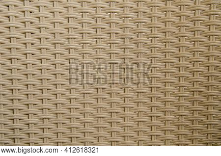 Texture Of Intertwined Beige Plastic Rods. Backrest Of A Garden Chair. Texture Pattern For Design, A