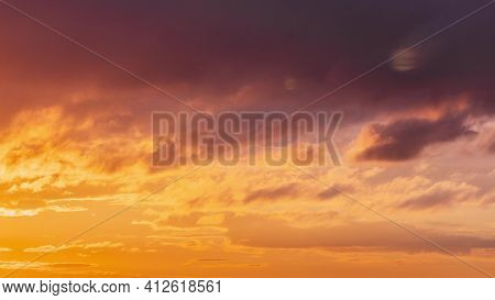 Time Lapse Time-lapse Sunrise Sunset Sky. Bright Dramatic Sky With Fluffy Clouds. Yellow, Orange, Bl