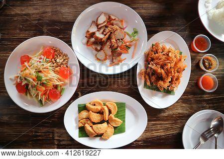 Deep Fried Shrimp, Deep Fried Pork With Deep Fried Sausage And Spicy Salad Or Thai Food