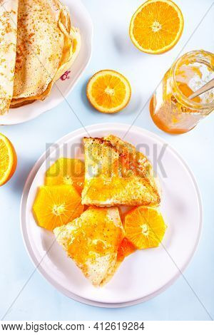 Thin Pancakes Crepes With Orange Fruit And Sweet Sauce Marmalade