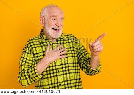 Photo Of Elderly Man Happy Smile Laugh Indicate Finger Empty Space Humor Joke Advert Advise Isolated