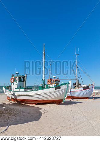 Older fishing boats on the beach of Løkken, North Jutland, Denmark