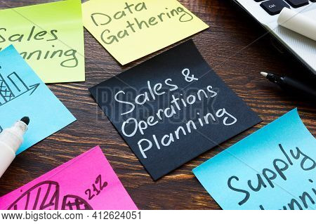 Sales And Operations Planning Concept. Memo Sticks On The Desk.